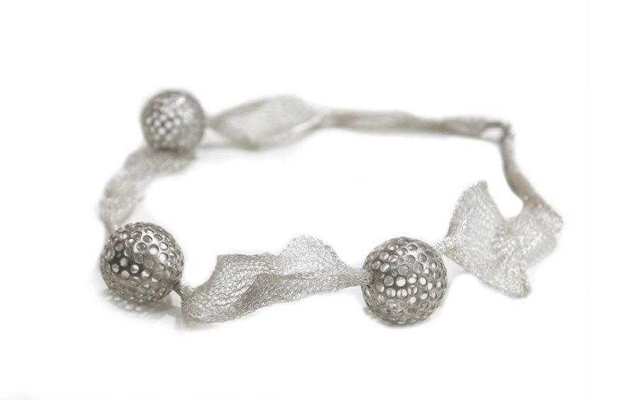 Punched Balls in Titanium String Necklace